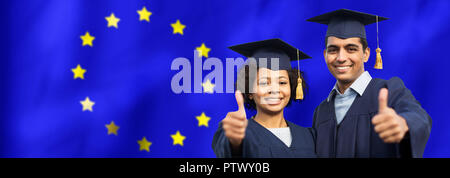 graduate students or bachelors showing thumbs up - Stock Photo