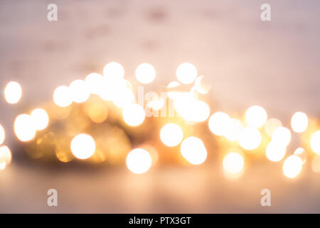 Abstract christmas decorations and lights on the background. Defocused image. - Stock Photo