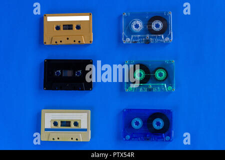 Old retro audio cassette tapes on blue background - Stock Photo