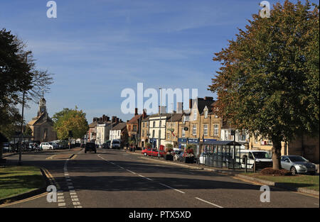 On a beautiful autumn morning the sun shines down on the Market Street in Brackley in Northamptonshire - Stock Photo