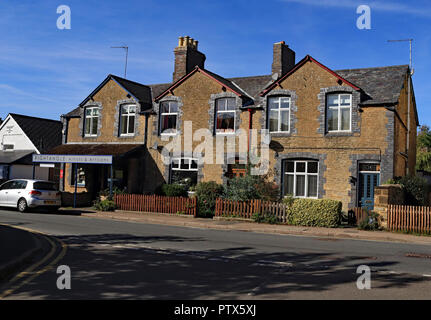 On a beautiful autumn morning the sun shines on the houses and the Art Gallery on Manor Road in Brackley in Northamptonshire. - Stock Photo