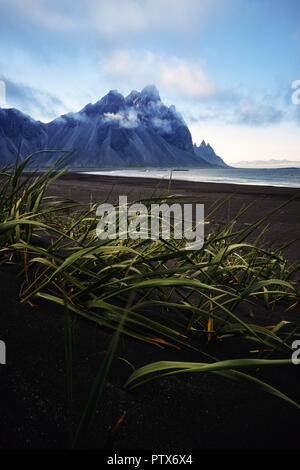 Vestrahorn mountain and the black sand beach at dusk in Stokksnes south east Iceland - Stock Photo