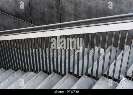 Berlin, Germany, August 31, 2018: Black and White Image of Staircase with Metal Railing - Stock Photo