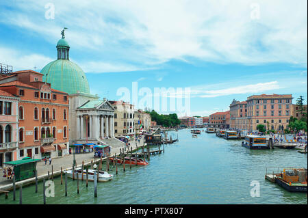 Venice, Italy - June 13, 2016: View from Ponte degli Scalzi towards the Grand Canal with San Simeone Piccolo church on the left with its striking dome - Stock Photo