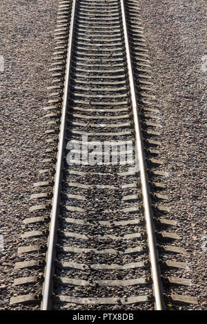 Railroad or railway close up view in perspective - Stock Photo