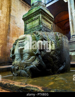 Upside-down head of Medusa in the subterranean Basilica Cistern, also known as Yerebatan Sarnici. Istanbul, Turkey. - Stock Photo