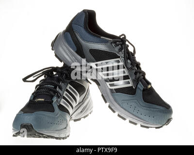 Istanbul, Turkey - January 29, 2014: New Adidas outdoor running shoes Taken at studio and isolated on white. - Stock Photo