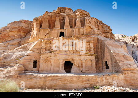 The Triclinium is built in front of the Obelisk Tomb near the entrance to the necropolis of Petra in Jordan. - Stock Photo