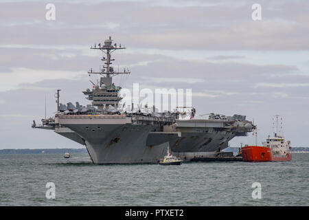 US Navy warship, the aircraft carrier USS Harry S Truman (CVN 75) at anchor in The Solent to visit Portsmouth, UK between the 6th-10th October 2018. - Stock Photo
