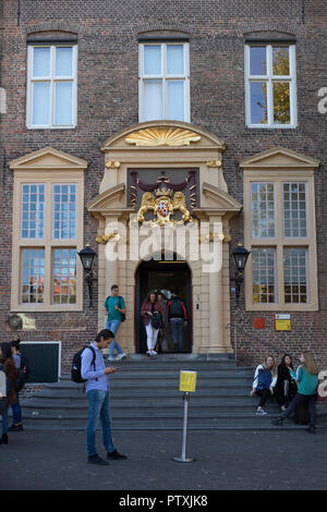 Utrecht, Netherlands - September 27, 2018: Entrance of the Utrecht University at the Janskerkhof with the coat of arms of Utrecht above the fornt door - Stock Photo