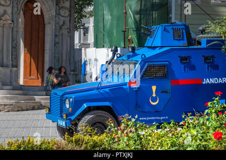 Istanbul, Turkey, September 2018: Bright blue painted armoured car of the Turkish police in front of the entrance of the Teppich Museum in the old tow - Stock Photo