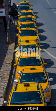 Istanbul, Turkey, September 2018: A row of taxis in a suburb of Istanbul, view from above - Stock Photo