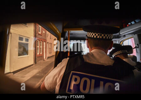 Superintendent Matt Boyle looks out of a patrol van window as Merseyside Police officers carry out a Stop and Search operation in Bootle, Liverpool - Stock Photo