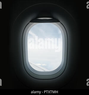Looking out through an airplanes porthole window during a flight. - Stock Photo