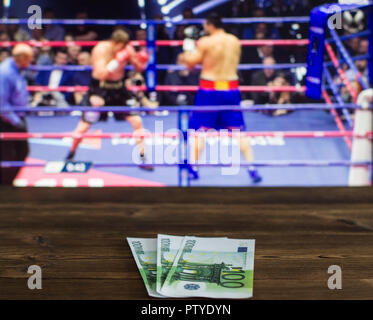 Euro money against the background of the TV on which show boxing, ring - Stock Photo