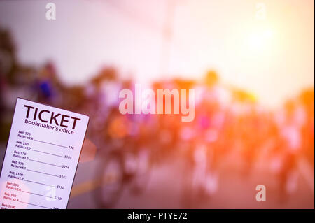 Bookmaker ticket on the background of the TV showing cycling, sports betting, cycling - Stock Photo