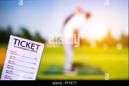 Bookmaker ticket on the background of the TV showing golf, sports betting, game golf - Stock Photo