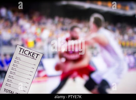 Bookmaker ticket on the background of a TV on which basketball is shown - Stock Photo