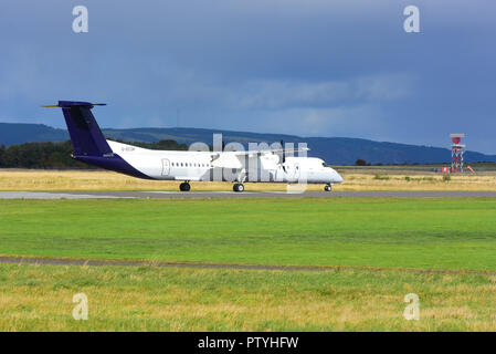 Taxiing on arrival at Inverness Dalcross airport is German registered Cessna Citation 750 X. D-BUZZ. - Stock Photo