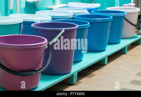 Room with cleaning tools, buckets, mops - Stock Photo