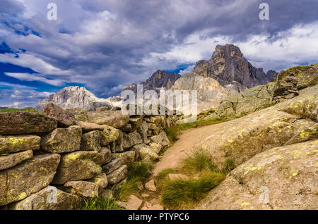 Italy Trentino Dolomites - Trench of the First World War on the crest of the little Cavallazza. In the background the Pale di San Martino. - Stock Photo
