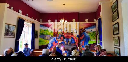 Painting showing train drivers on the footplate of a steam locomotive inside the railway station cafe,Lakeside & Haverthwaite Railway,Cumbria,UK - Stock Photo