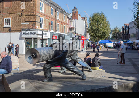Statue of Lino Workers, High Street, town centre, Staines-upon-Thames, Surrey - Stock Photo