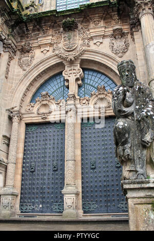Cathedral door in the medieval city of Santiago de Compostela - Stock Photo