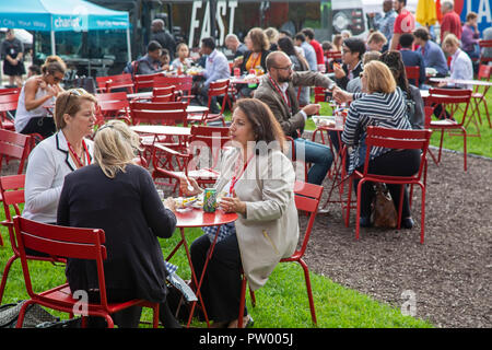 Detroit, Michigan - People eat lunch on a warm autumn day in Spirit Plaza. The plaza was created by closing Woodward Avenue, a main downtown street. - Stock Photo