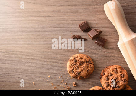 Homemade cookies with chocolate and rolling pin on table. Horizontal composition. Top view - Stock Photo