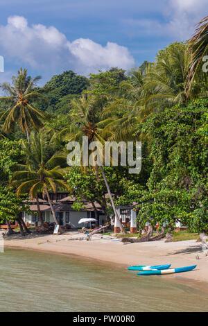 Kayaks on the tropical beach on Koh Kood island in Thailand