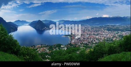 Lugano, Switzerland, May 12, 2018. Beautiful panoramic view of  Lugano city from Monte Brè Mountain. - Stock Photo
