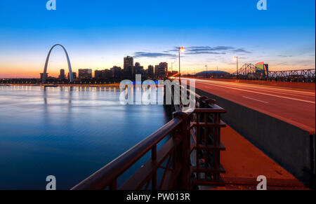 The St. Louis, Missouri skyline and Gateway Arch from Eads Bridge. - Stock Photo