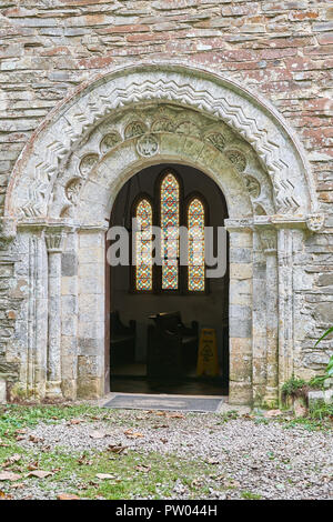 Norman arched entrance to the twelfth century church of St Anthony at the headland of St Anthony's Head on the Roseland, Cornwall, England. - Stock Photo