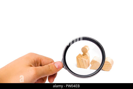 Magnifying glass is looking at a small figure of a man looks out of the remains of a large figure. The concept of revival and liberation, a way out of