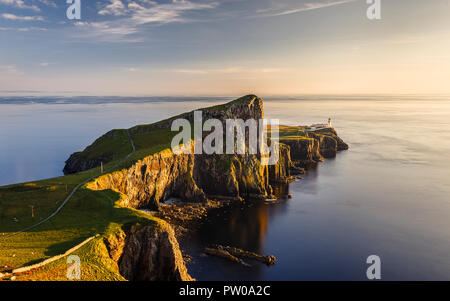 The cliffs and lighthouse at Neist Point on the Isle of Skye at sunset, Scotland - Stock Photo
