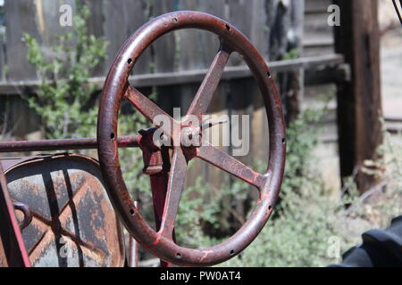 Rusted steering wheel on old truck - Stock Photo