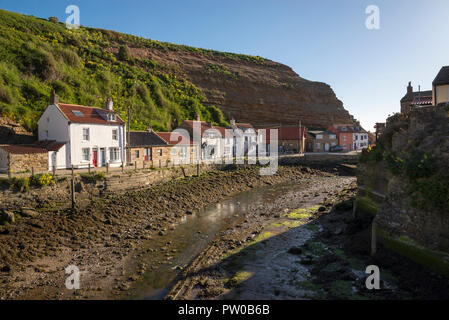 Staithes Beck and Cowbar Nab. Staithes is a beautiful historic fishing village on the coast of North Yorkshire, England. - Stock Photo