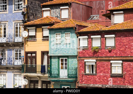 Traditional multicolored houses in the Ribeira quarter in Porto, Portugal - Stock Photo