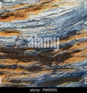 Macro image of iron stained stone texture at the beach in Cornwall. - Stock Photo