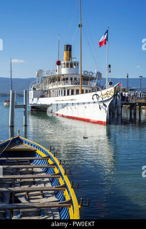 Swiss historic Belle Epoque paddle steamboat Savoie in the old port at Yvoire along Lake Geneva / lac Léman, Haute-Savoie, France - Stock Photo