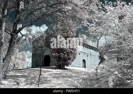 Medieval church of S. Miguel do Castelo, thirteenth century, Guimaraes, Portugal. Used infrared filter. - Stock Photo