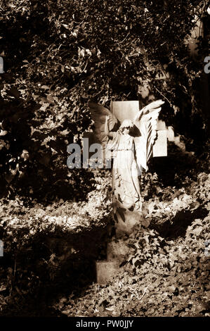 Sepia toned stone angel in Highgate Cemetery, London. - Stock Photo