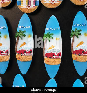 Small surfboard fridge magnet souvenirs on sale at a Newquay souvenir shop - home of Boardmasters Festival. - Stock Photo