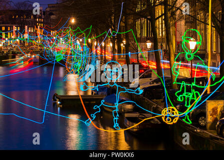 Amsterdam canal Herengracht during Amsterdam Light Festival with artwork 'Paths Crossing' of Ralf Westerhof. - Stock Photo