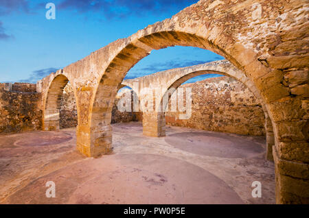 Rethymno town in Crete island, Greece. Old arched vault of Fortezza fortress. - Stock Photo