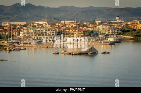 Olbia in Sardinia. Landscape around Olbia, view from cruise ship arriving into the Olbia harbor in Sardinia island, morning scene - Stock Photo