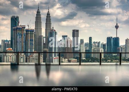 City skyline with infinity pool, Kuala Lumpur, Malaysia - Stock Photo