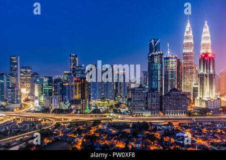 City skyline at night, Kuala Lumpur, Malaysia - Stock Photo