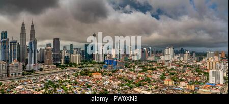 Panoramic view of city skyline, Kuala Lumpur, Malaysia - Stock Photo